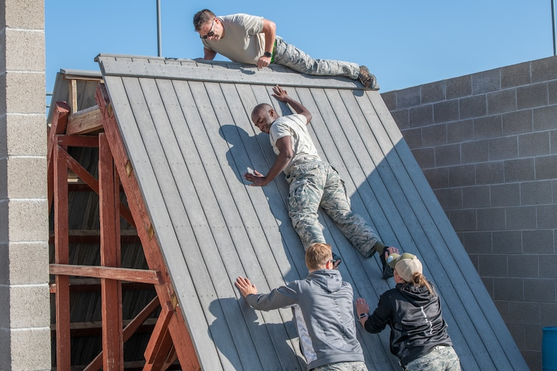 Reservists from the 419th Fighter Wing assist a fellow Airman to complete an obstacle Sept. 11, 2020, at Camp Williams, Utah
