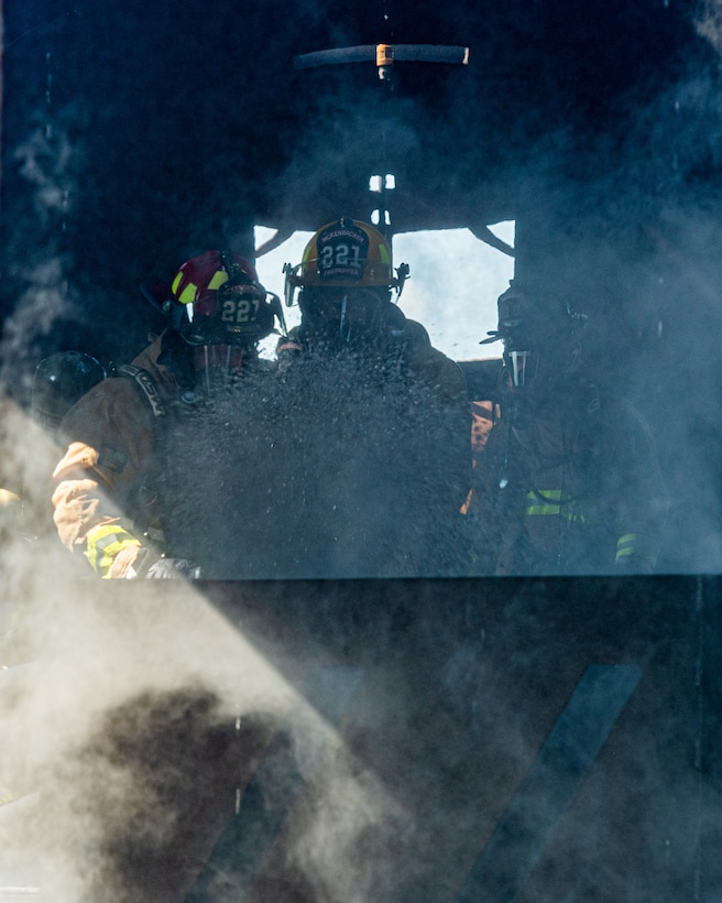 Firefighters from Rickenbacker Air National Guard extinguish an internal aircraft fire, Sept. 9, 2020, at Youngstown Air Reserve Station's burn pit. About 40 Citizen Airmen from RANG's fire department came to the 910th Airlift Wing, Sept. 8-10, to do their annual live-fire training.