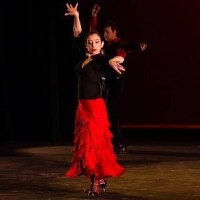 Lady in red dress dancing.