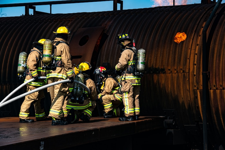 Firefighters from Rickenbacker Air National Guard prepare to breach Youngstown Air Reserve Station's burn pit, Sept. 9, 2020. About 40 Citizen Airmen from RANG's fire department came to the 910th Airlift Wing, Sept. 8-10, to do their annual live-fire training.