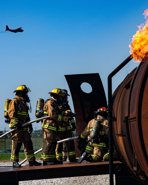 Firefighters from Rickenbacker Air National Guard breach Youngstown Air Reserve Station's burn pit, Sept. 9, 2020. About 40 Citizen Airmen from RANG's fire department came to the 910th Airlift Wing, Sept. 8-10, to do their annual live-fire training.