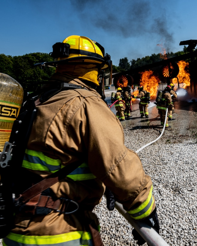 Firefighters from Rickenbacker Air National Guard fight an external aircraft fire, Sept. 9, 2020, at Youngstown Air Reserve Station's burn pit. About 40 Citizen Airmen from RANG's fire department came to the 910th Airlift Wing, Sept. 8-10, to do their annual live-fire training.
