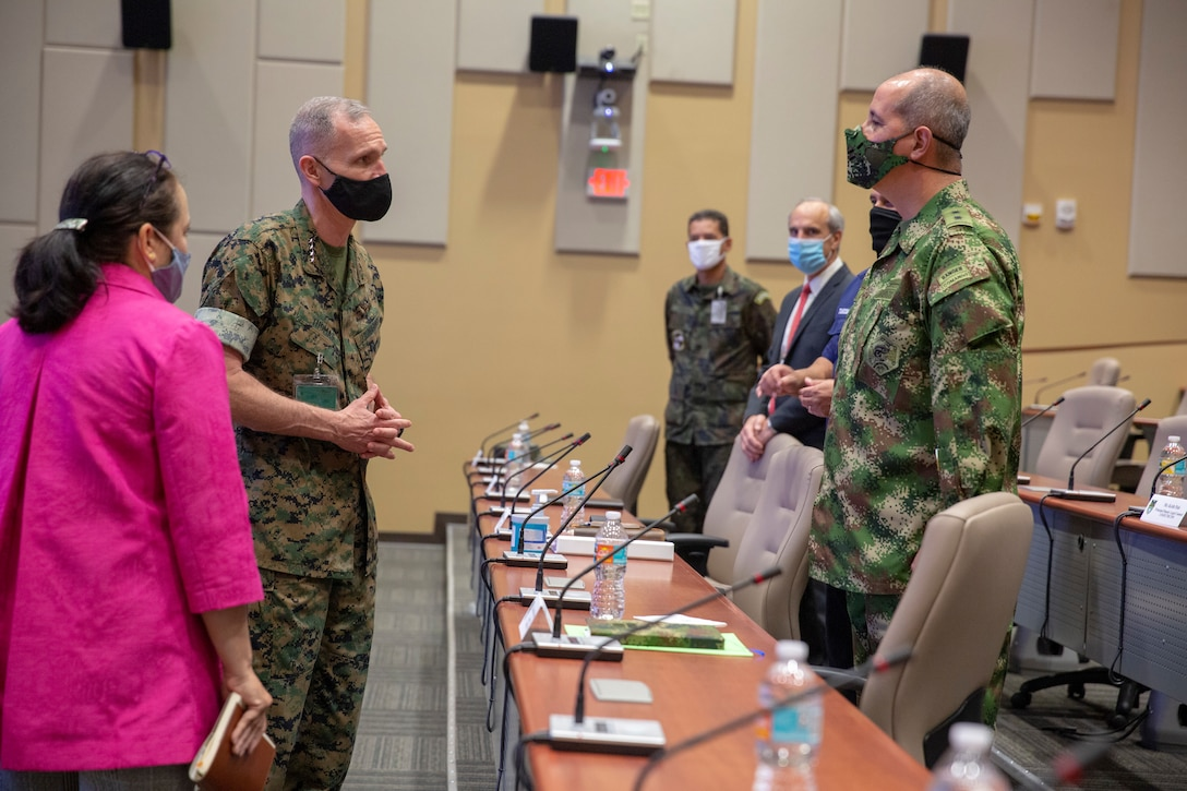 U.S. Marine Gen. Gary L. Thomas, assistant commandant of the U.S. Marine Corps, and Ambassor Jean E. Manes, civilian deputy commander of U.S. Southern Command, speak with Colombian Army Brig. Gen. Juan Carlos Correa Consuegra, director of Exercises and Coalition Affairs, SOUTHCOM, during a visit to U.S. Marine Corps Forces, South, and SOUTHCOM, in Miami, Florida, Sept. 9.