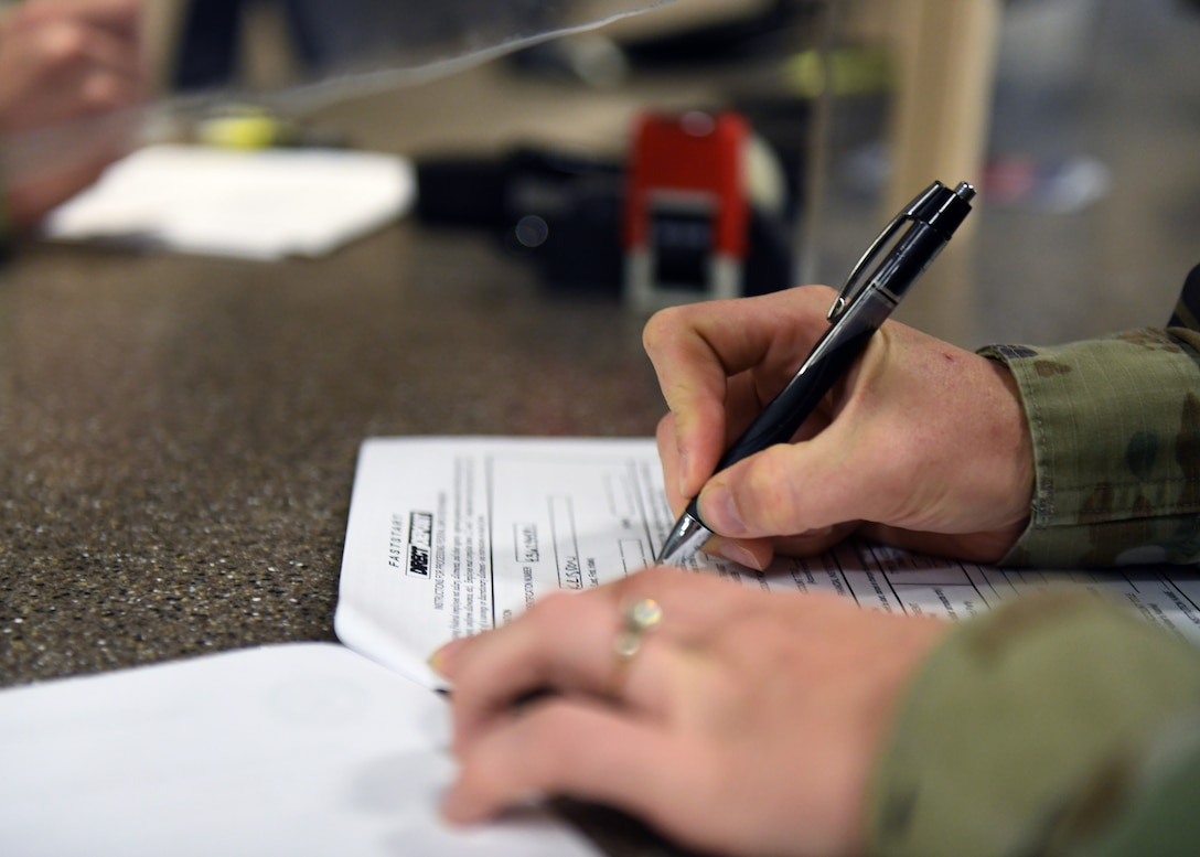Staff Sgt. Kridson Stetson, 9th Comptroller Squadron (CPTS) financial operations flight NCOIC, fills out a travel voucher Sep. 9, 2020, at Beale Air Force Base, California. The 9th CPTS provides financial management support to all units at Beale. (U.S. Air Force photo by Airman 1st Class Luis A. Ruiz-Vazquez)