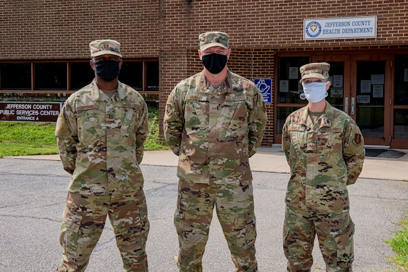 Three members of the West Virginia National Guard's 167th Airlift Wing, from left, Capt. Rodney Brown, Staff Sgt. James Murray, and Staff Sgt. Erin Engle, are part of the COVID-19 contact tracing team at the Jefferson County Health Department, Martinsburg, W.Va., Aug. 20, 2020.