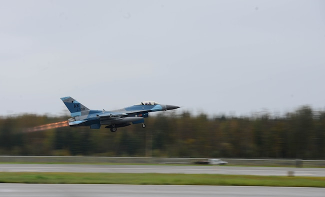 An F-16 Fighting Falcon, assigned to the 18th Aggressor Squadron, takes off in support of exercise Valiant Shield on Eielson Air Force Base, Alaska, Sept. 8, 2020. The 18th AGRS are trained to prepare Combat Air Force, joint and allied aircrew through challenging, realistic, threat replication, training test support, academics and feedback. Valiant Shield 20 provides an optimal training environment to increase readiness and joint interoperability. (U.S. Air Force photo by Staff Sgt. Sean Martin)
