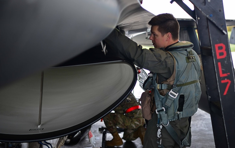 U.S. Air Force Capt. Daniel Simpson, an 18th Aggressor Squadron pilot, performs a pre-flight check before departing to support exercise Valiant Shield on Eielson Air Force Base, Alaska, Sept. 8, 2020. Valiant Shield 20 provides an optimal training environment to increase readiness and joint interoperability. (U.S. Air Force photo by Staff Sgt. Sean Martin)