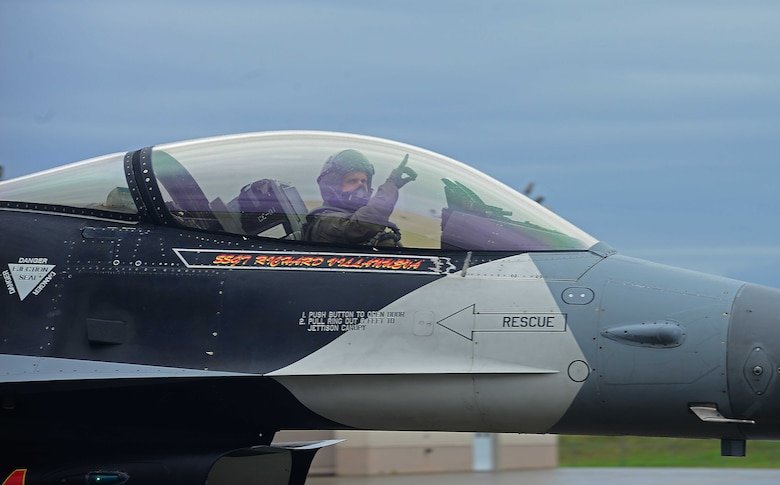 An F-16 Fighting Falcon pilot assigned to the 18th Aggressor Squadron gives a hand signal before takeoff to support exercise Valiant Shield on Eielson Air Force Base, Alaska, Sept. 8, 2020. Valiant Shield is a biennial, U.S.-only field training exercise with a focus on integration of joint training among U.S. forces in relation to current operational plans. Valiant Shield 20 provides an effective, flexible and capabilities centered force, enabling real-world proficiency in response to a variety of crises. (U.S. Air Force photo by Staff Sgt. Sean Martin)