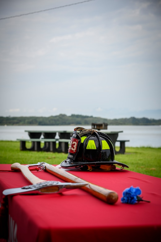 A firefighter helmet and two axes sits on a table at Misawa Air Base, Japan, Sept. 11, 2020. This tribute symbolizes the heroic efforts made by the firefighters who rushed into the World Trade Center buildings during 9/11. (U.S. Air Force photo by Airman 1st Class China M. Shock)