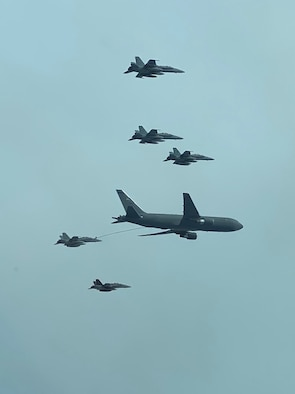 A New Hampshire Air National Guard KC-46A Pegasus refuels five Marine Corp's F/A-18D Hornets with the Marine All-Weather Fighter Attack Squadron 242, as the fighters returned home to Marine Corps Air Station Yuma, Ariz. from MCAS Iwakuni, Japan on Sept. 10, 2020, over the Pacific Ocean. This marks the first official transoceanic coronet mission ever accomplished with a Pegaus refueler, which began Sept. 9 and involved 16 aerial refuelings of the fighters. (courtesy photo)
