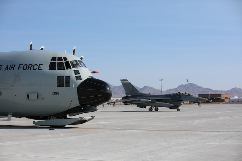 Elements of the 109th Airlift wing participate in a joint exercise at Nellis Air Force Base in Las Vegas demonstrating the capability to establish and land at an austere landing area, secured by the 321st Contingency Response Squadron, carrying ordinance for rearming F-16 fighter jets from the 140th fighter wing (Buckley AFB).