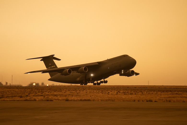 A C-5M Super Galaxy takes off at Travis Air Force Base, California, Sept. 9, 2020. Wildfires across California propelled smoke and ash into the troposphere, impacting air quality. (U.S. Air Force photo by Heide Couch)