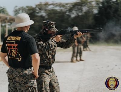 SSgt Vigil coaches a Military student on the proper employment of the M1014 Shotgun.