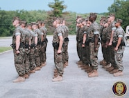 Students stand in formation as they learn how to conduct guard mount. Guard mount is a formal tradition in which Military Police personnel form for inspection prior to assuming their duties on the watch. This inspection is used to ensure Military Police personnel are mentally and physically fit for duty.