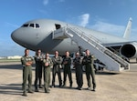 From left, Capt. Erik Earle, Capt. Chris Schimmel, Maj. Matt Valentino, Master Sgt. Brett Peterson, Capt. Jordan Gauvin, Chief Master Sgt. Michael George and Maj. Leon Rice pose in front of a KC-46A Pegasus on Sept. 8, 2020, at Kadena Air Base, Japan. The Pease Airmen executed the first official transoceanic coronet ever accomplished with a Pegaus refueler, which began Sept. 9 and involved 16 aerial refuelings of five F/A-18 jets.