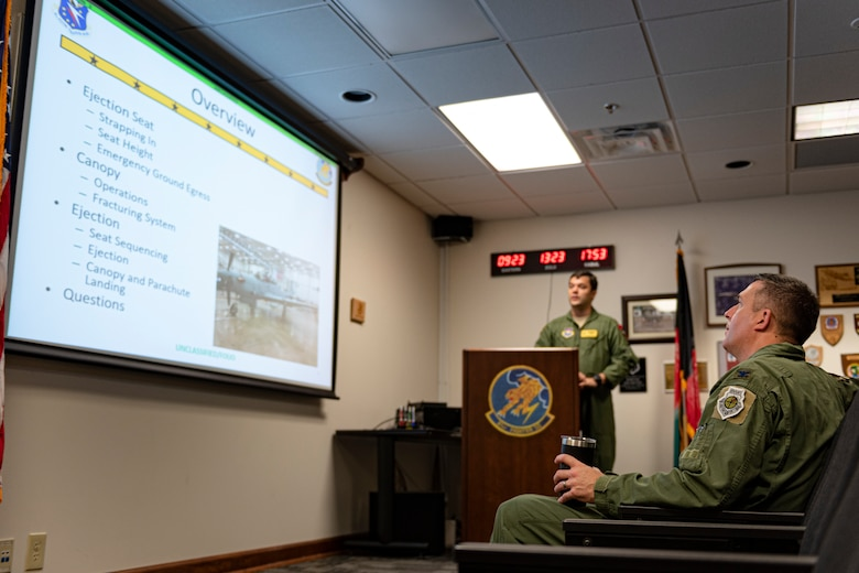 A photo of the 23d Wing commander attending a brief