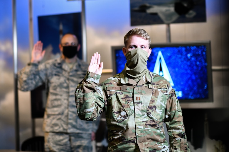 """U.S. Air Force Capt. Brandon George, Space and Missile Systems Center project officer at Los Angeles Air Force Base, California, participates in a ceremonial swearing-in event broadcasted from the Air Force Association's 2020 Virtual Air, Space and Cyber Conference and administered by Gen. John """"Jay"""" Raymond, United States Space Force Chief of Space Operations, at Los Angeles Air Force Base, California, Sept. 15, 2020. To officially transfer from one military service to another, a military member separates from the current service and commissions or enlists into the new service in their current rank. (U.S. Space Force photo by Van Ha)"""
