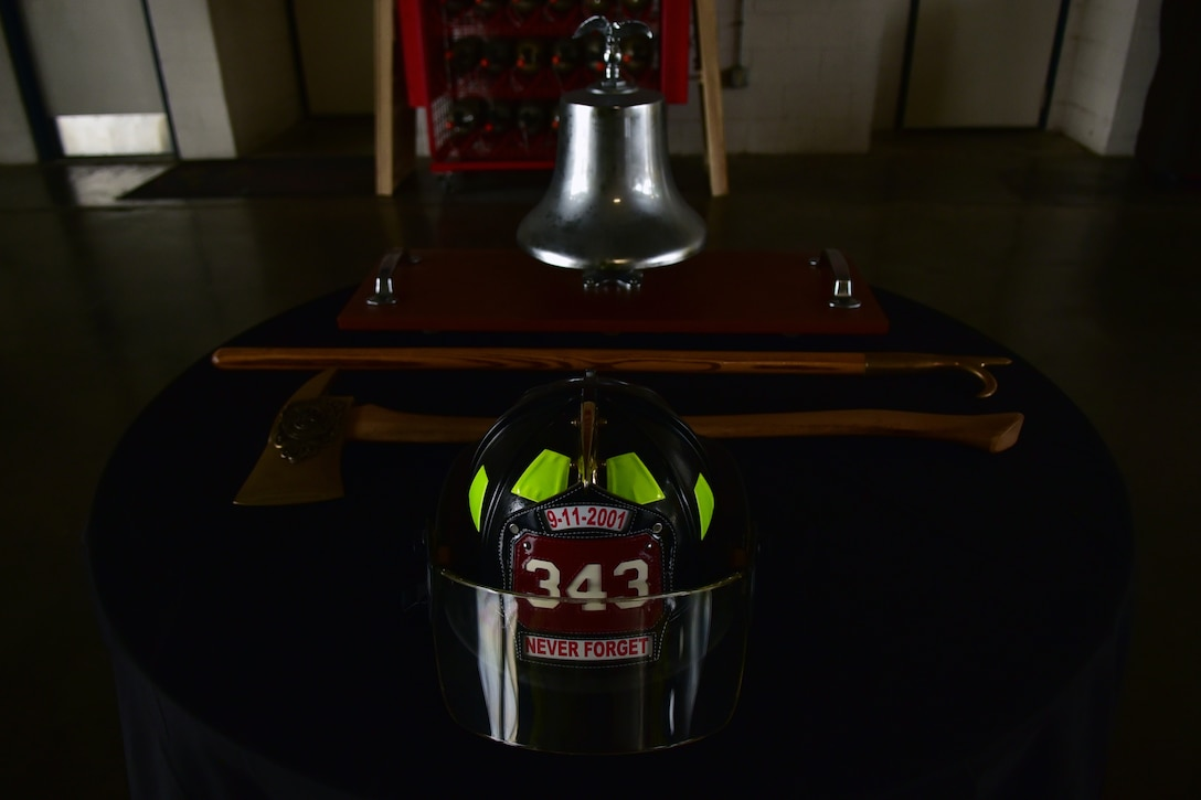 A table is set up with a helmet, axe, pick and bell in preparation for an annual 9/11 remembrance ceremony at Seymour Johnson Air Force Base, North Carolina.