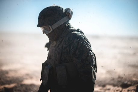A U.S. Marine with 1st Transportation Support Battalion, 1st Marine Logistics Group, grounds himself after a CH-53E Super Stallion from Marine Heavy Helicopter Squadron 465, 3rd Marine Aircraft Wing, lifts a Humvee during a helicopter support team training exercise in Yuma, Ariz., on Jan. 23, 2019.