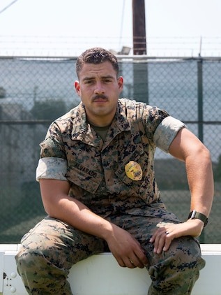 Cpl. Jeremy Alvarado, a military working dog trainer and handler with the Provost Marshal's Office, Security and Emergency Services Battalion, Marine Corps Base Camp Pendleton, poses for a photo at the PMO kennels. Alvarado believes that honoring Hispanic heritage is important in broadening our understanding of each other and important to the diversity within Hispanic culture itself. Alvarado is a native of Yauco, Puerto Rico. (U.S. Marine Corps photo by Lance Cpl. Angela Wilcox)