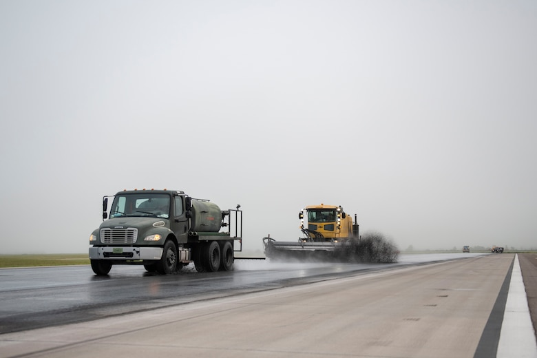 97th Civil Engineer Squadron removes runway rubber.