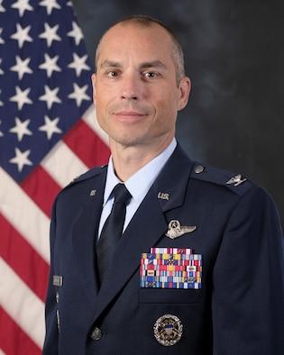 photo of Colonel Weinbrecht with U.S. Flag behind him.