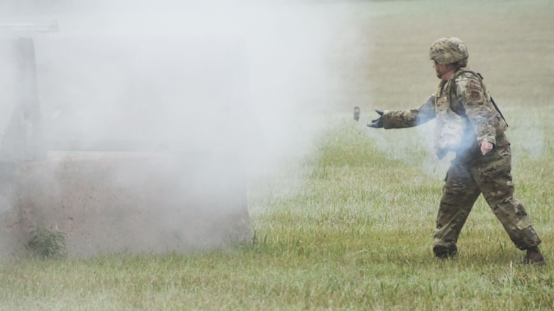 Master Sgt. Stacey Botzet, 931st Civil Engineer Squadron program manager, throws a ground burst simulator as part of a three-day 931st Air Refueling Wing operational readiness exercise Sept. 12, 2020, at McConnell Air Force Base, Kan.  The GBS's were to simulate smoke after an attack, to evaluate 931st ARW's Airmen's ability to respond after an explosives attack.