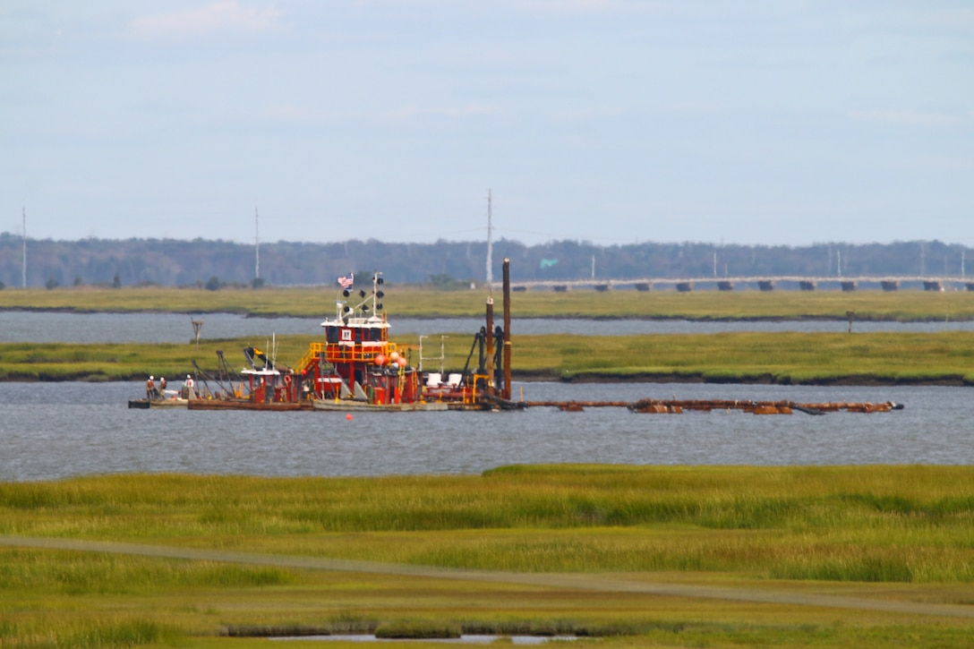 The Dredge Fullerton, owned and operated by Barnegat Bay Dredging Company, conducts dredging in the New Jersey Intracoastal Waterway near Stone Harbor, NJ in September 2020. Sediment is being pumped onto Gull Island and Sturgeon Islands, two low lying marsh islands.