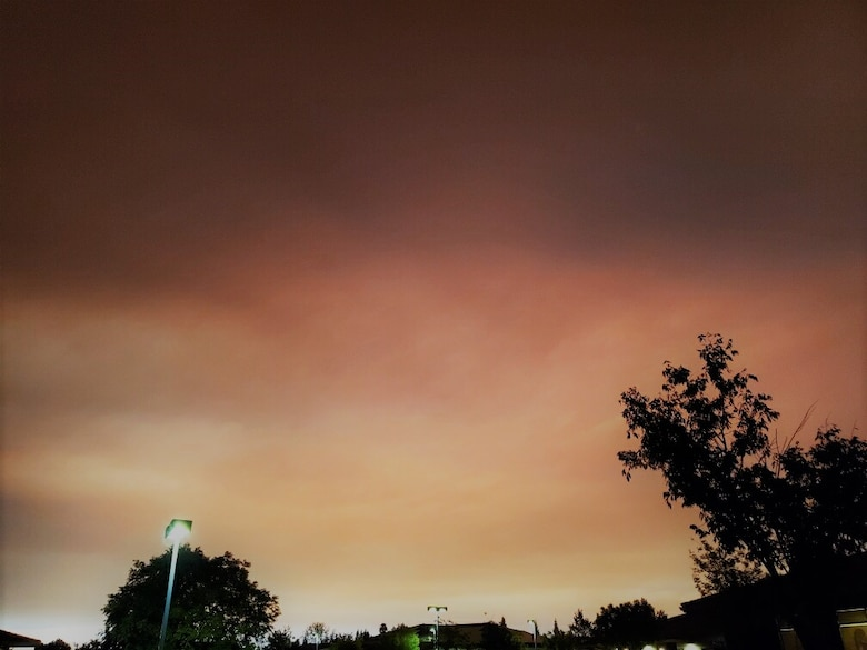 Northwest view of sky from the 940th ARW headquarter's building as the smoke thickens from the neighboring Elkhorn and August Complex Wildfires.