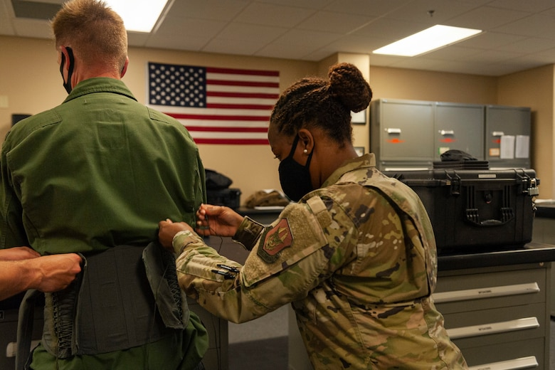 Photo of Col. Schultz being fitted for life support