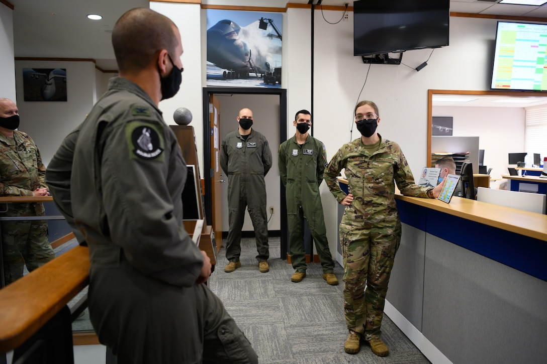 Airman gives briefing to leadership