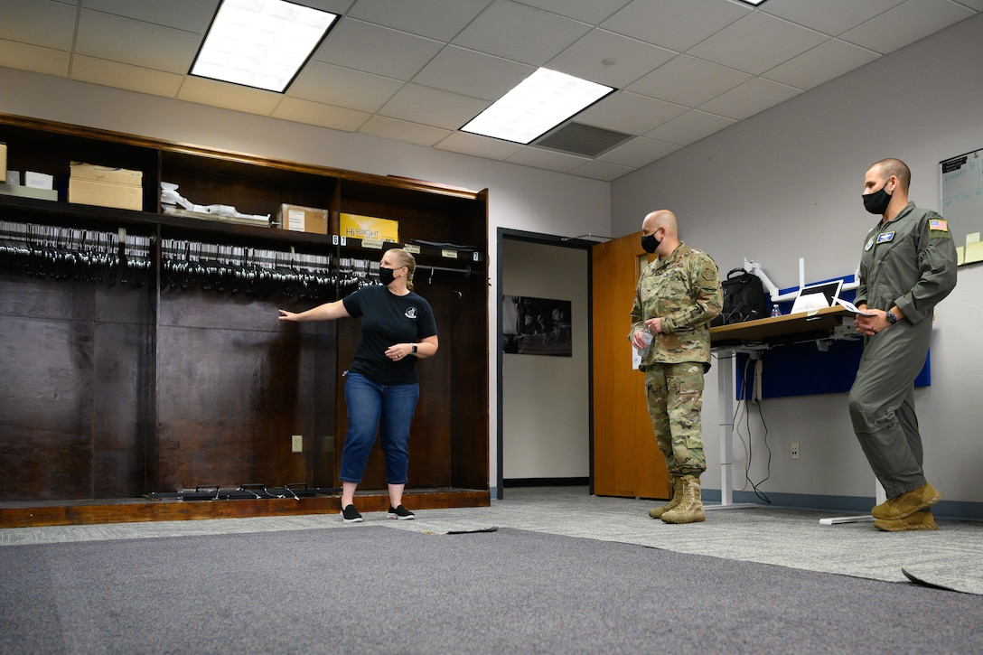 Training manager shows old supply room to leadership.