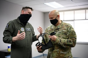 Airman shows chief virtual reality headset.