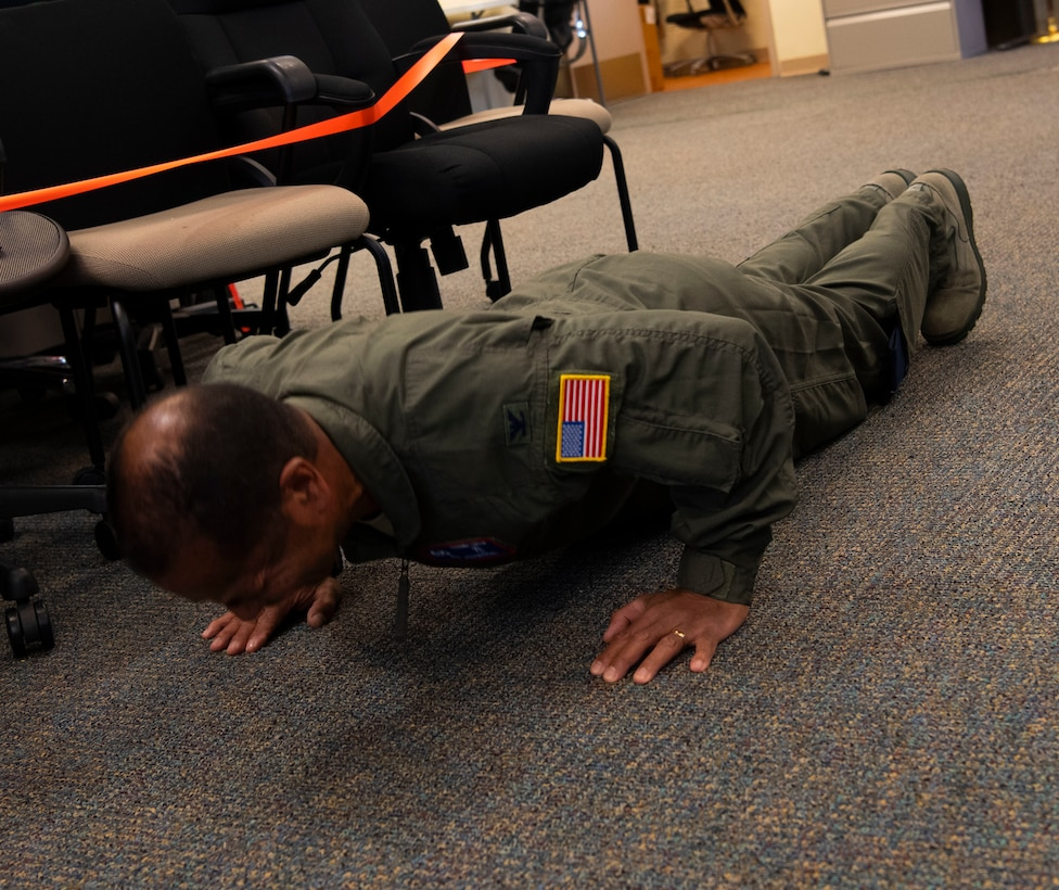 A photo of U.S. Air Force Col. Edward Johnson, 624th Aeromedical Staging Squadron commander, doing push-ups as part of a Resiliency Tactical Pause at Joint Base Pearl Harbor-Hickam, Hawaii, Sept. 12, 2020, during the 624th Regional Support Group Unit Training Assembly.