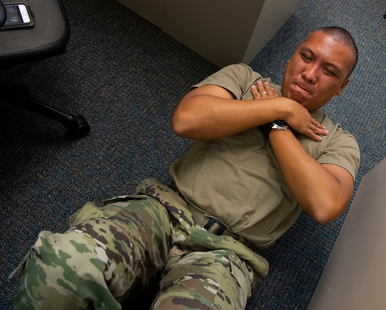 A photo of U.S. Air Force Master Sgt. Jerry Pagaduan, acting first sergeant for the 624th Aeromedical Staging Squadron, doing push-ups as part of a Resiliency Tactical Pause at Joint Base Pearl Harbor-Hickam, Hawaii, Sept. 12, 2020, during the 624th Regional Support Group Unit Training Assembly.