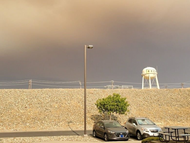 The smoke creates a contrast of color over Beale AFB. The view of the water tower shows a stark comparison to how thick the ash and smoke have become during this fire season.
