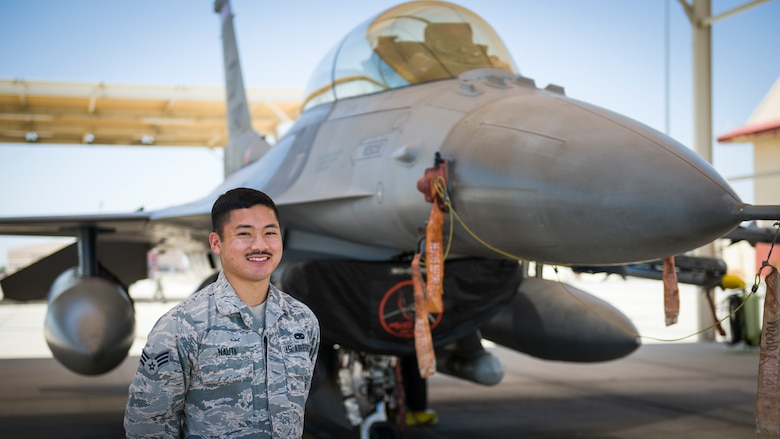Senior Airman Nathan Nauta, electrical and environmental technician assigned to the 926th Maintenance Support Squadron, Nellis Air Force Base, Nevada, poses for a photo in front of an F-16 Fighting Falcon at Edwards Air Force Base, California, July 24. (Air Force photo by Giancarlo Casem)