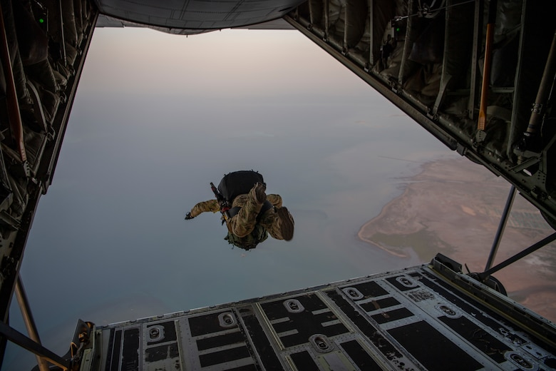 A person jumps from a plane