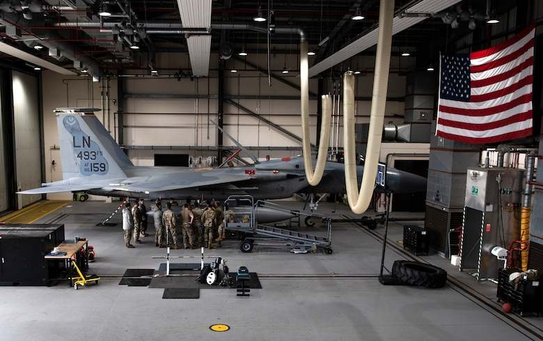 U.S. Air Force Airmen, assigned to the 48th Component Maintenance Squadron fuels systems maintenance shop, attend an Agile Combat Employment training at Royal Air Force Lakenheath, England, Aug. 31, 2020. The training was designed to enhance ACE capabilities by teaching Airmen to perform multiple roles outside the scope of their regular daily duties. (U.S. Air Force photo by Airman 1st Class Jessi Monte)