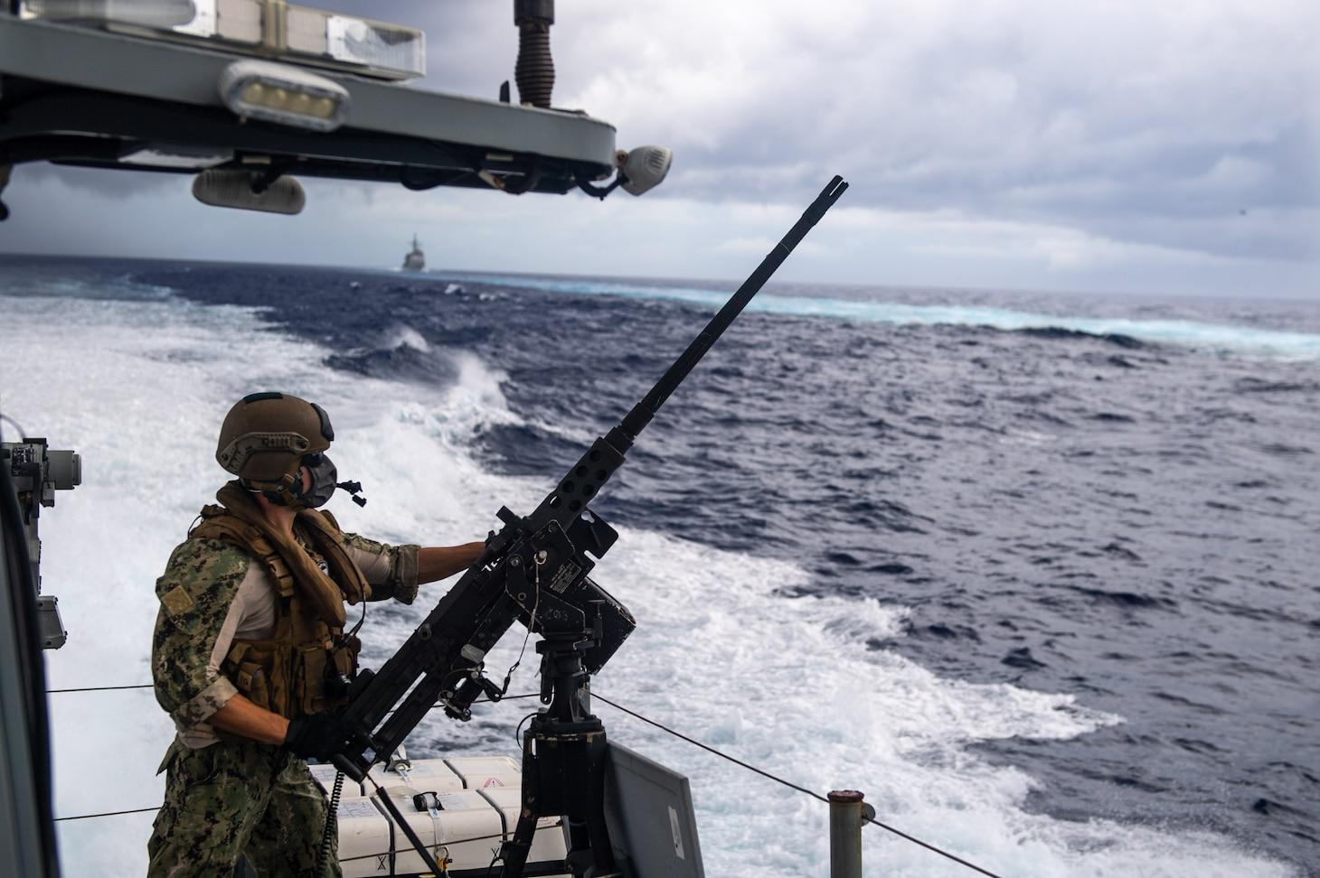A Sailor assigned to Coastal Riverine Squadron 3, mans a .50-caliber machine gun while aboard a Mark VI patrol boat in support of Valiant Shield 2020.