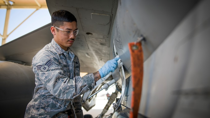 Senior Airman Nathan Nauta, electrical and environmental technician assigned to the Senior Airman Nathan Nauta, an electrical and environmental technician assigned to the 926th Maintenance Support Squadron, Nellis Air Force Base, Nevada, works on an F-16 Fighting Falcon at Edwards Air Force Base, California. (Giancarlo Casem)