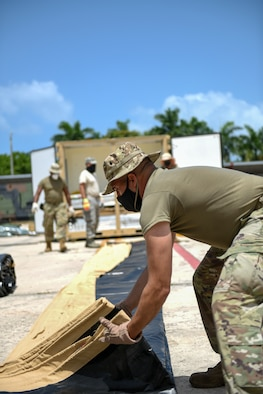 U.S. Airmen with the 156th Civil Engineer Squadron, Puerto Rico Air National Guard, set up tents and generators as part of a two week long training exercise on the Disaster Relief Beddown Systems at Muñiz Air National Guard Base, Aug. 18, 2020. Specialized Airmen from the New Mexico ANG, Arkansas ANG, Pennsylvania ANG, North Carolina ANG, Iowa ANG and Colorado ANG arrived at Muñiz to train Puerto Rico National Guard Airmen and Soldiers on how to properly assemble, operate, inventory and disassemble the DRBS equipment. (U.S. Air National Guard photo by Tech. Sgt. Rafael D. Rosa)