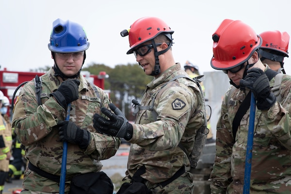 West Virginia National Guard's 35th Chemical, Biological, Radiological, Nuclear, and High Yield Explosive (CBRNE) Enhanced Response Force Package (CERFP) search and extraction team members participate in a rescue scenario during a Vigilant Guard Massachusetts exercise at Joint Base Cape Cod Nov. 6, 2018. The Massachusetts National Guard hosted Vigilant Guard 19-1, a full-scale civil-military exercise, with 46 federal, state, local and civilian organizations, Nov. 5-9, 2018, in various locations throughout the Commonwealth of Massachusetts. (U.S. Army National Guard photo by Sgt. Zoe Morris)