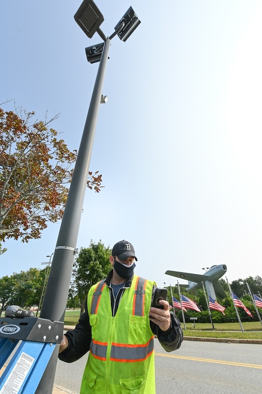 Alan Blackington, traffic data analyst for Accurate Counts of North Reading, Mass., checks a traffic monitoring camera transmission by his phone at Hanscom Air Force Base, Mass., Sept. 15. The cameras will allow 66th Civil Engineering Division officials to perform an environmental impact assessment of traffic across the installation. (U.S. Air Force photo by Todd Maki)