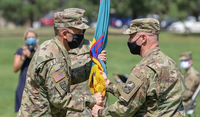 Army Col. Michael S. Hatfield receives the colors of the 100th Missile Defense Brigade (GMD) from Lt. Gen. Daniel L. Karbler, the commanding general of U.S. Army Space and Missile Defense Command, during a change of command ceremony at the Patriot Park Parade Field at Peterson Air Force Base, Aug. 31, 2020. Hatfield inherits command of the 100th Brigade from Col. Christopher M. Williams who had been in command since Dec. 7, 2017.  (U.S. Army National Guard photo by Staff Sgt. Zachary Sheely)