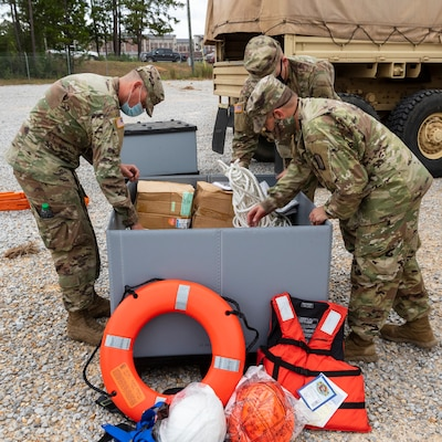 Mississippi Army National Guard Soldiers assigned to an engineer composite team pack supplies in preparation to conduct high-water rescues in response to Hurricane Sally at Camp Shelby Joint Force Training Center, Miss., Sept. 15, 2020. The Mississippi National Guard is prepared to conduct civil support operations, including search and rescue and debris removal, to support local and state authorities.