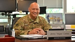 Air Force Brig. Gen. Jimmy Canlas sitting at his desk