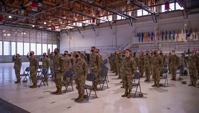 Photo of Airmen raising their hands during oath