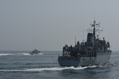 ARABIAN GULF (Sept. 10, 2020)  The Royal Navy Hunt-class mine countermeasures vessel HMS Chiddingfold (M37), right, sails in formation with a Mark VI patrol boat attached to Commander, Task Force (CTF) 56 during a bi-lateral mine countermeasure exercise between the U.K. and U.S. in the Arabian Gulf, Sept. 10.  CTF 56 is deployed to the U.S. 5th Fleet area of operations and conducts mine warfare operations in support of naval operations to ensure maritime stability in the Central Region, connecting the Mediterranean and Pacific through the Western Indian Ocean and three strategic chokepoints to the free flow of global commerce.  (U.S. Army photo by Staff Sgt. Timothy Clegg)