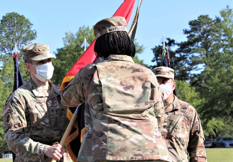 Col. Janene Marshall-Gatling, outgoing 4th Brigade (Personnel Services) commander (right), passes the 4th Brigade (PS) unit guidon to Brig. Gen. Stephen Iacovelli (left), 94th Training Division-Force Sustainment commanding general, as she relinquished command of the brigade during the unit's change of command ceremony held on Victory Field at Fort Jackson, S.C., July 11, 2020. Marshall-Gatling served as the 4th Brigade (PS) commander for two years before relinquishing command to Col. Aaron Wilkes. (U.S. Army Reserve photo courtesy of 1st Lt. Matthew Rutledge, 4th Brigade (PS), 94th TD-FS)